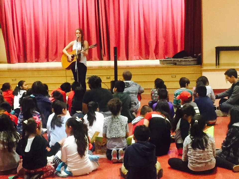 Liz Fohl performing at Charles White Elementary