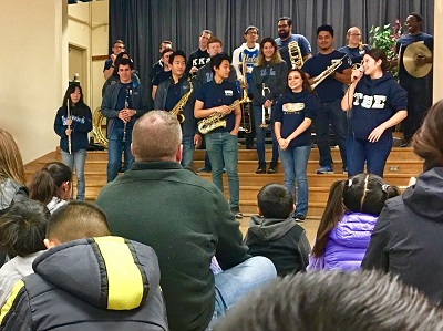 Tau Beta Sigma & Kappa Kappa Psi performing at Charles White Elementary